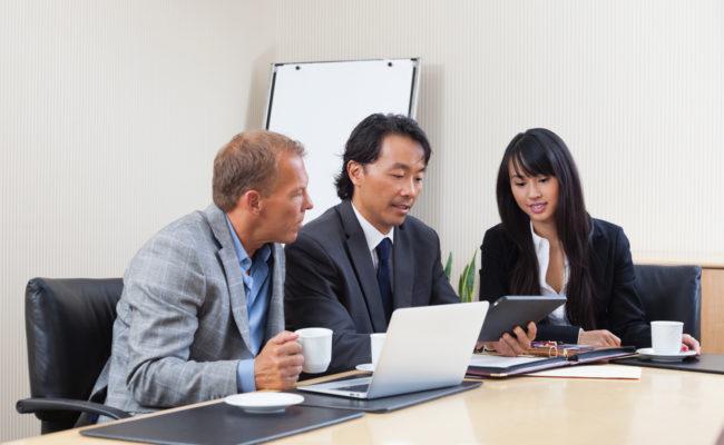 Business people using tablet in meeting